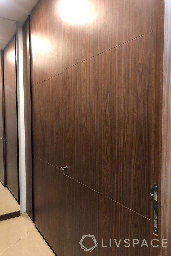 duplex interior design-wooden wall paneling-walk in closet