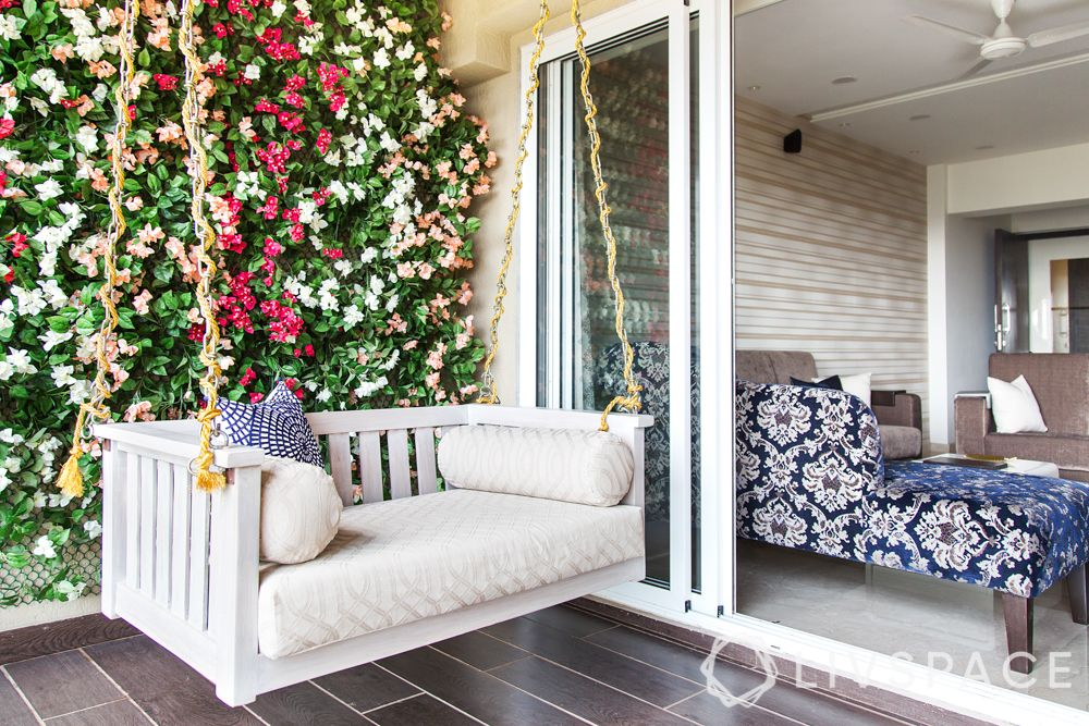 balcony design ideas-floral wall-cushioned swing