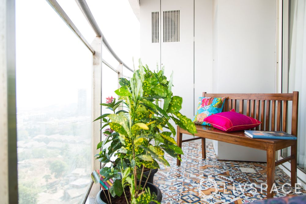 balcony design ideas-bright cushions-potted plant