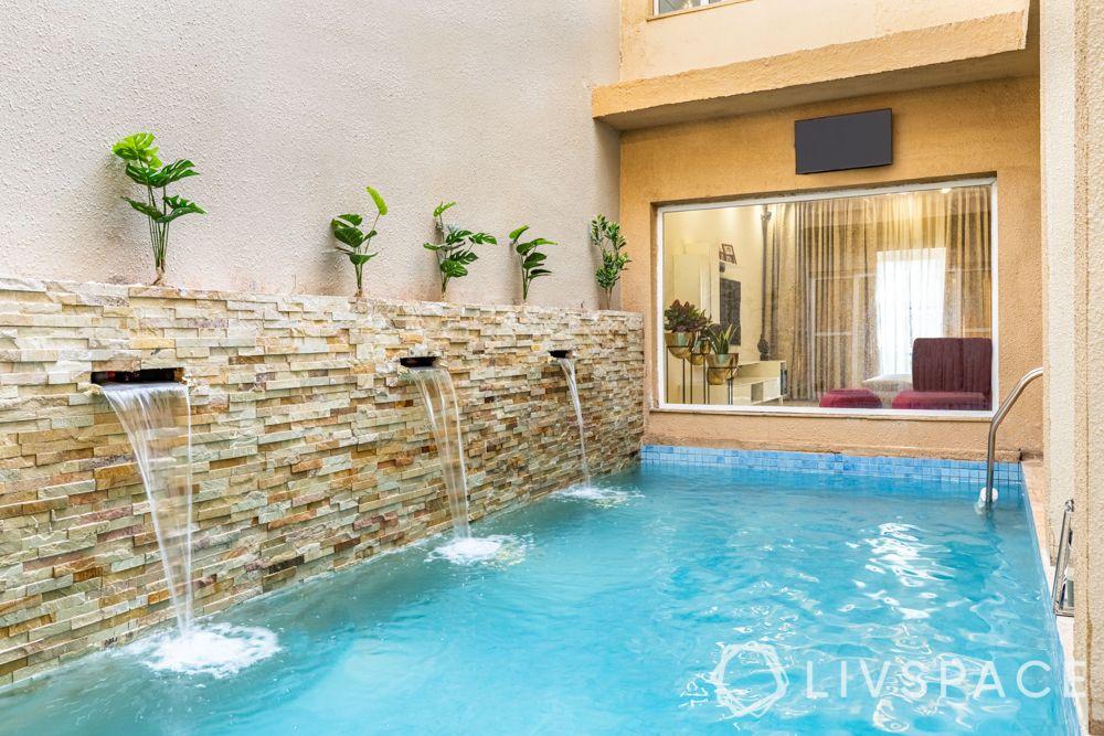 villa interior designer-pool-stone cladded wall