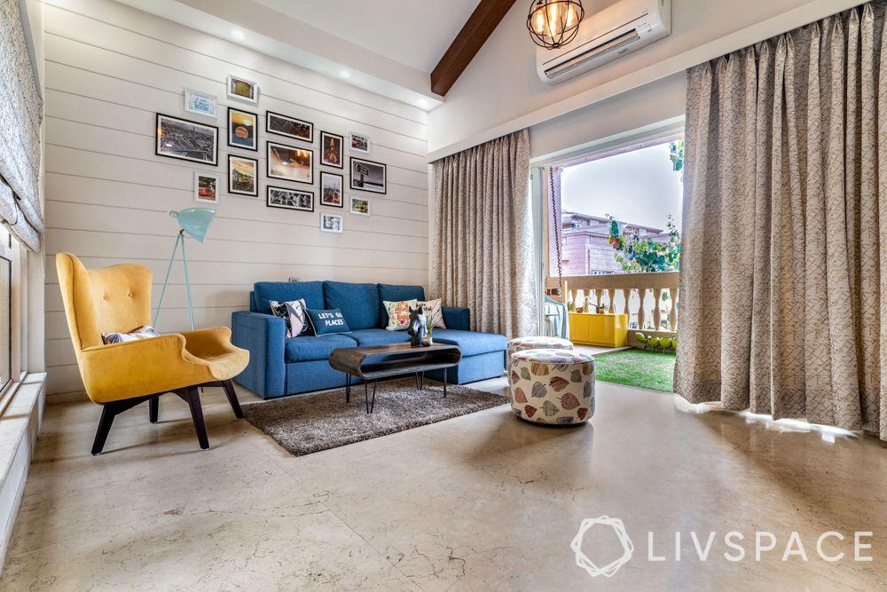 villa interior designer-family room-yellow armchair-gallery wall