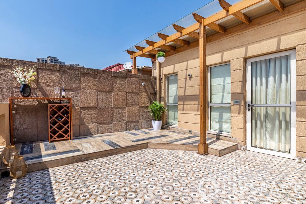 villa interior designer-hexagonal tiles-stone cladded walls