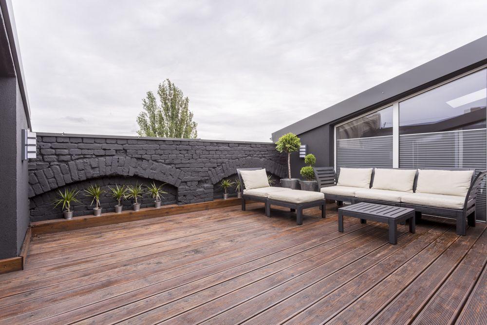 balcony grill design-brick wall-patio