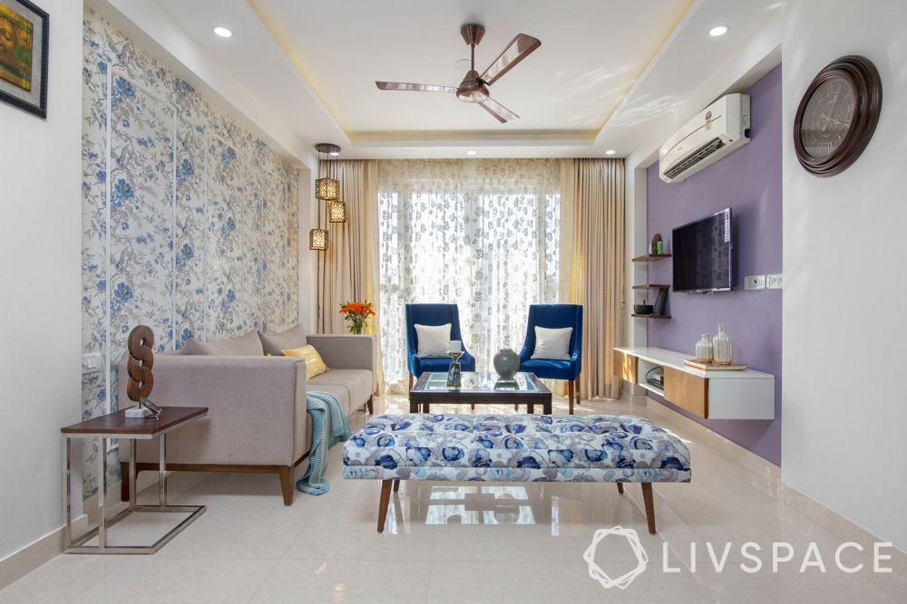 modern home interior-living room-floral prints-blue wallpaper
