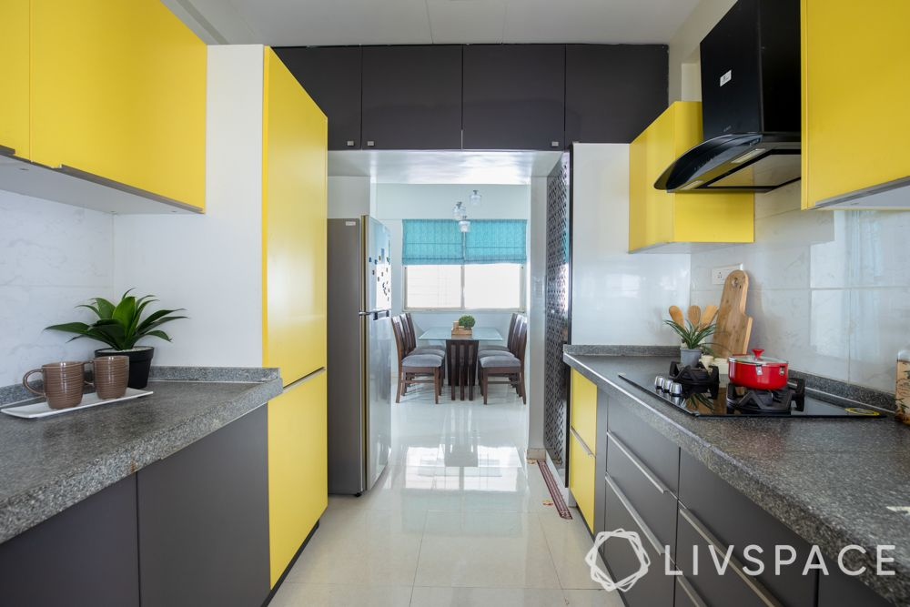 interior for 2 bhk-yellow kitchen-granite countertop