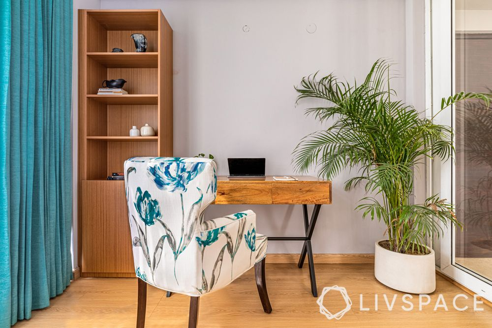 4BHK house design-laminate bookshelf-wooden table-potted plant