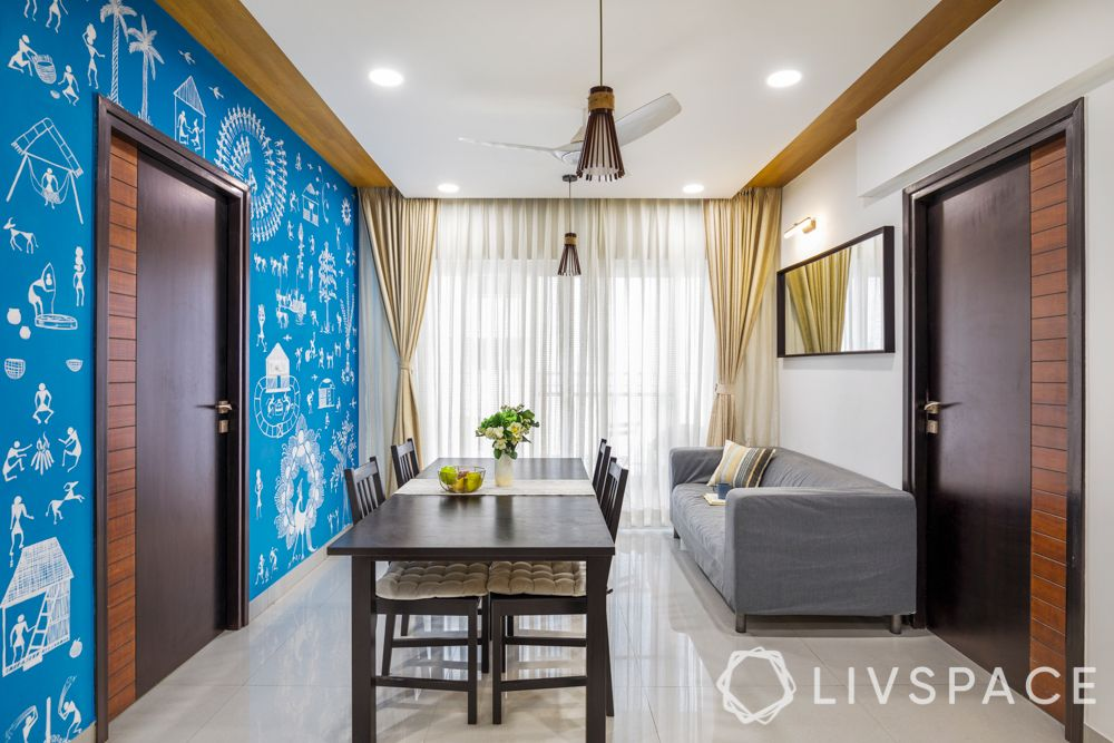 3 bhk home decoration-blue wall colour-warli painting