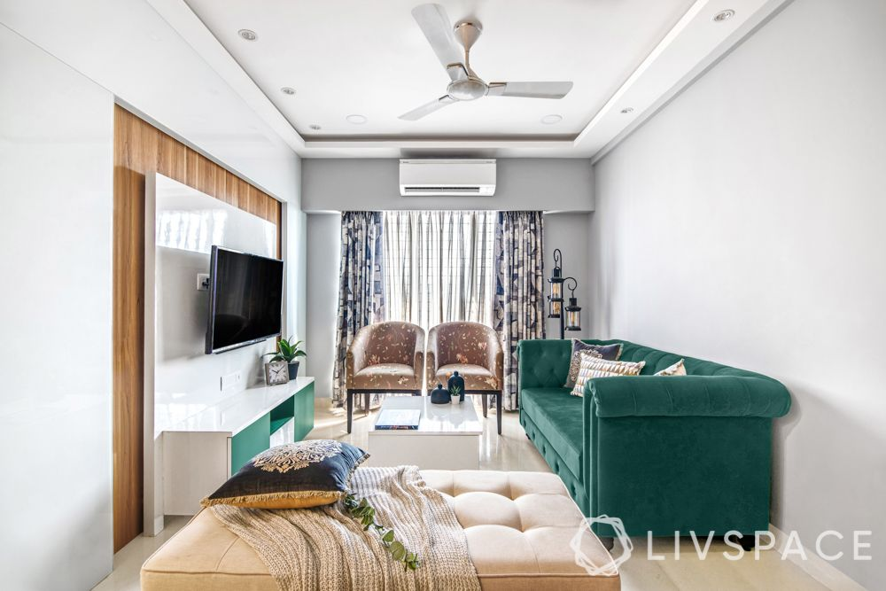 2 bhk flat interiors-living room-emerald green sofa