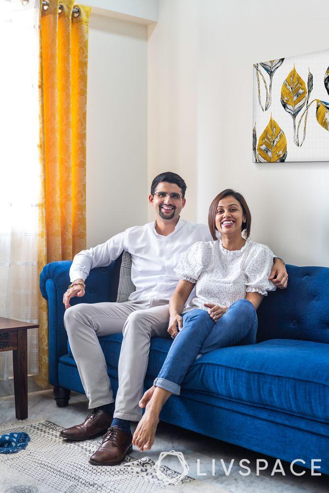 best interior designers-blue chesterfield sofa