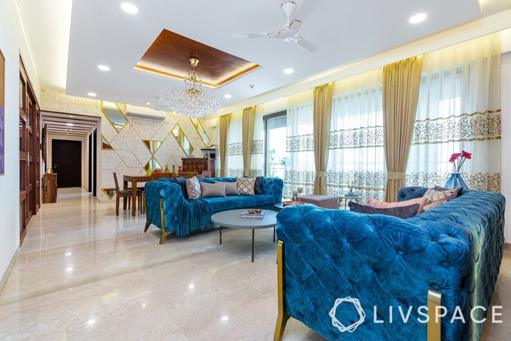 best interior designers-indian traditional living room-blue sofa