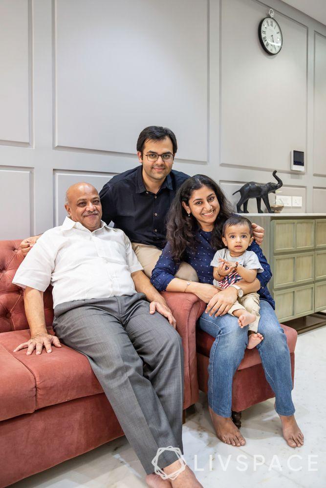 pink sofa-grey walls-indian family
