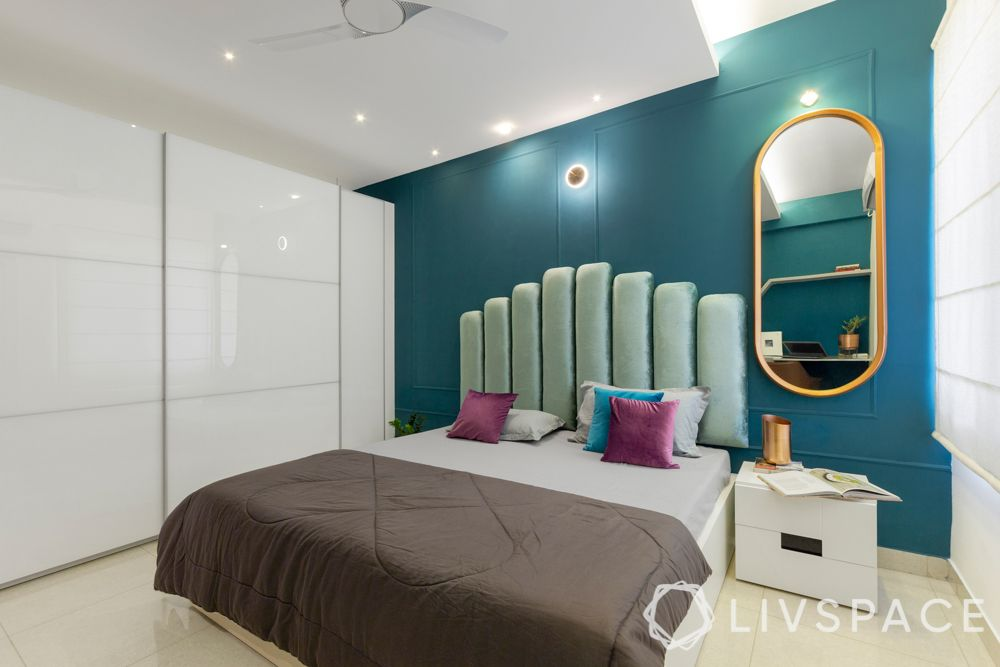 interior decoration of 3bhk flat-blue accent wall-white wardrobes