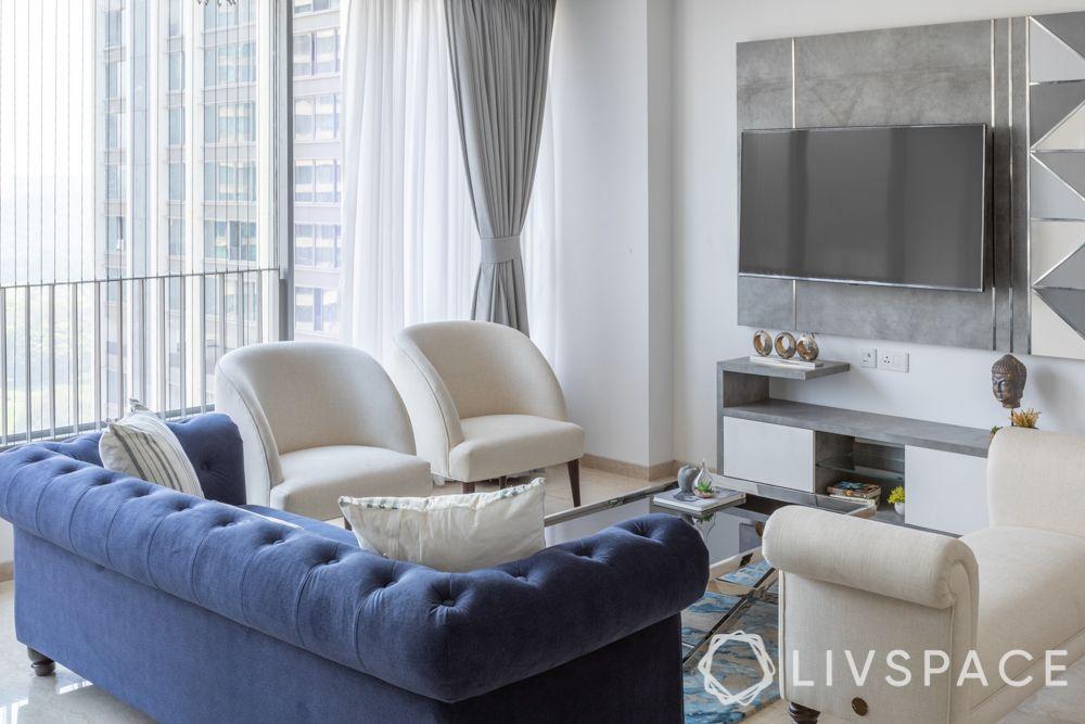 blue sofa-white chairs