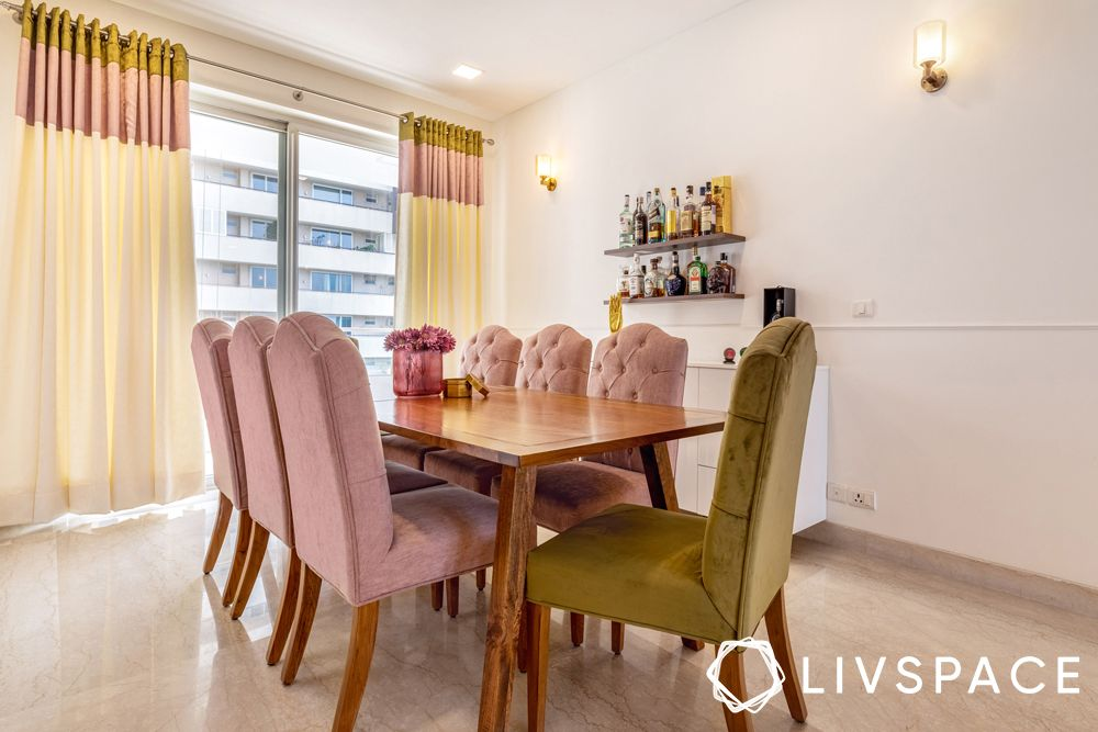 4bhk-dining room-dusty pink chairs-olive green chair-wooden table