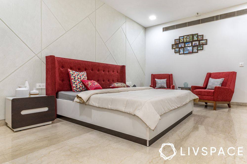 Gurgaon interiors-red headboard-red chairs-table