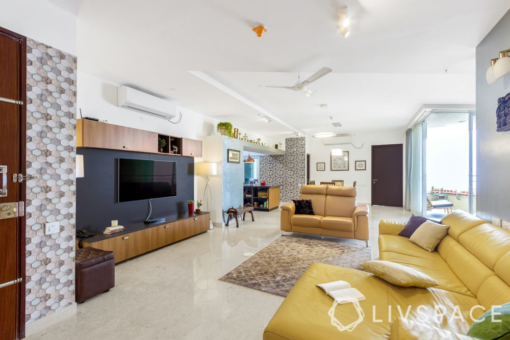 3bhk interior plan-yellow couch-tv unit designs
