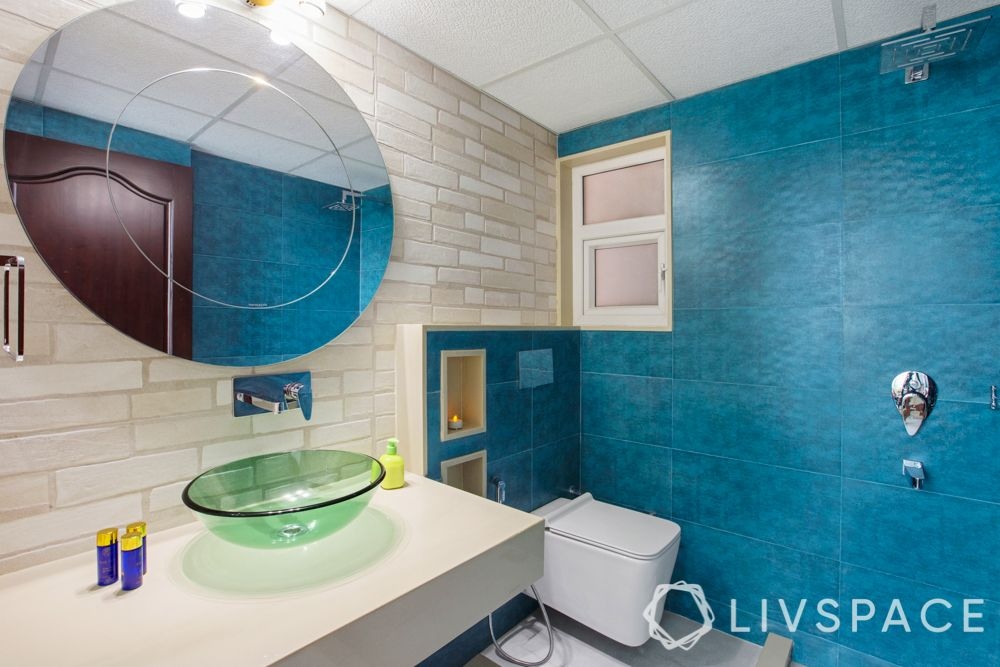 bathroom ideas-blue wall-round mirror