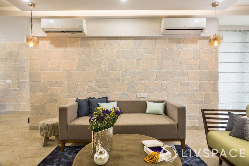 best 3BHK interior design-living room-stone finish wall-sofa