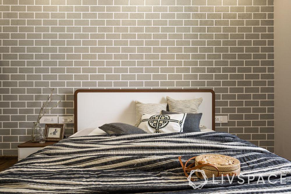 3bhk Gurgaon interiors-textured wall-bedroom-high gloss laminate bed