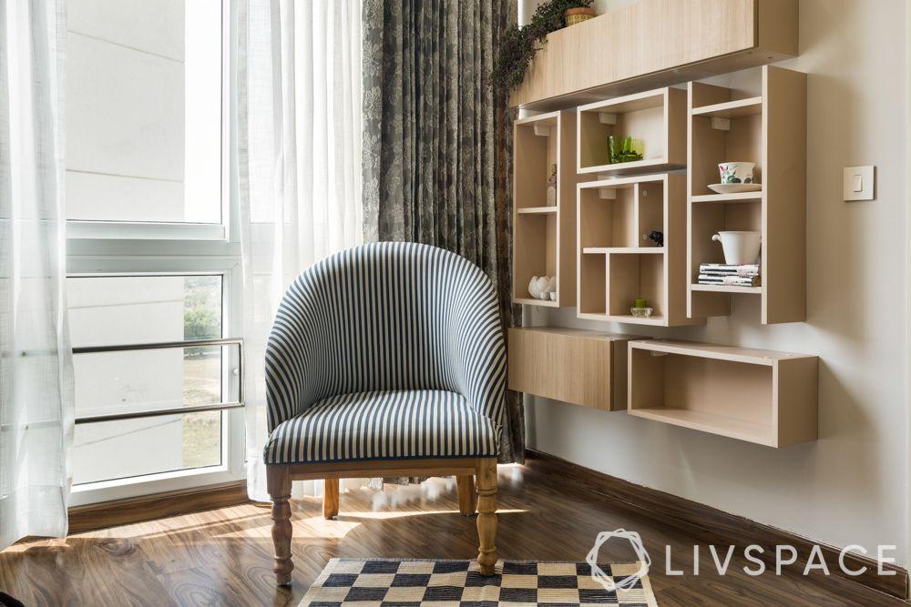 best 3BHK interior design-study room-wall mounted storage unit-British style armchair