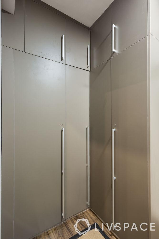 3BHK flat interiors-autumn leaf laminate wardrobe