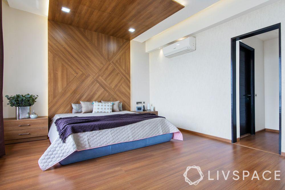 laminate vs veneer-laminate flooring-bedroom-bed panel