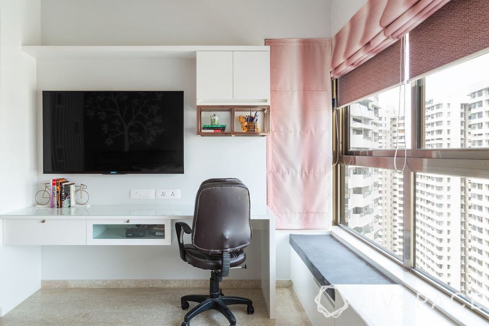 4bhk interiors-bay window-TV cum study unit-rose gold knobs
