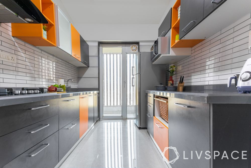 vastu colors for kitchen-orange and grey cabinets