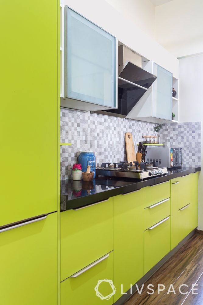 vastu kitchen-green cabinets-handles-patterned backsplash