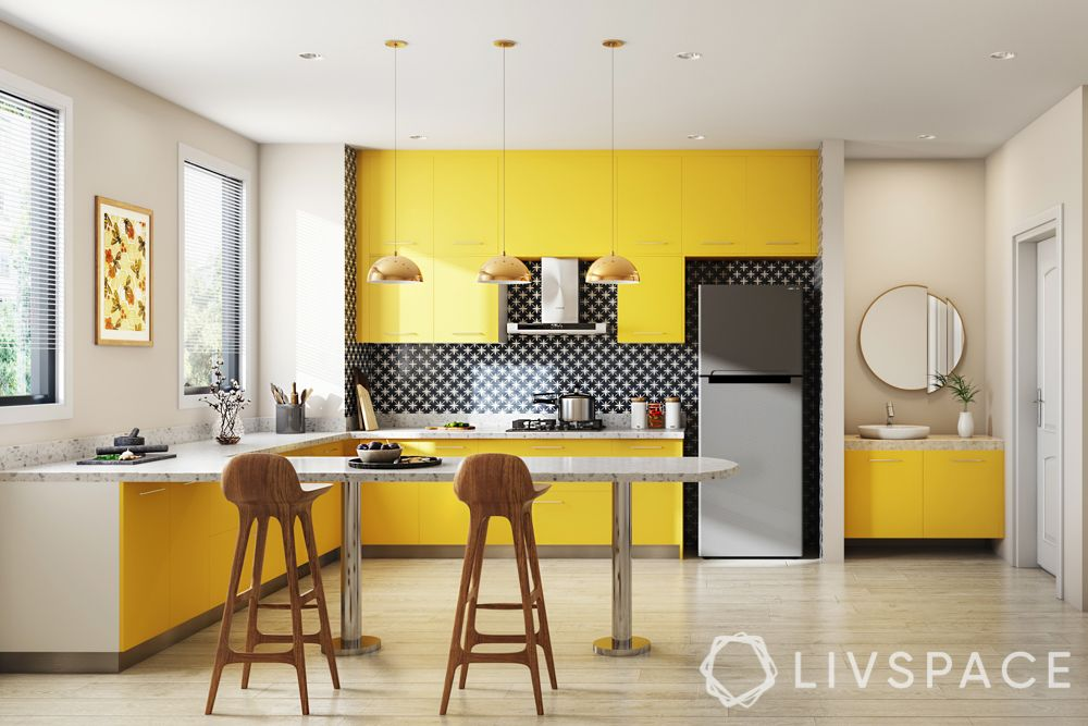 vastu colors for kitchen-yellow cabinets-handles-lights-chairs-breakfast table