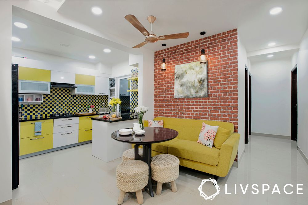 exposed brick wall-yellow kitchen