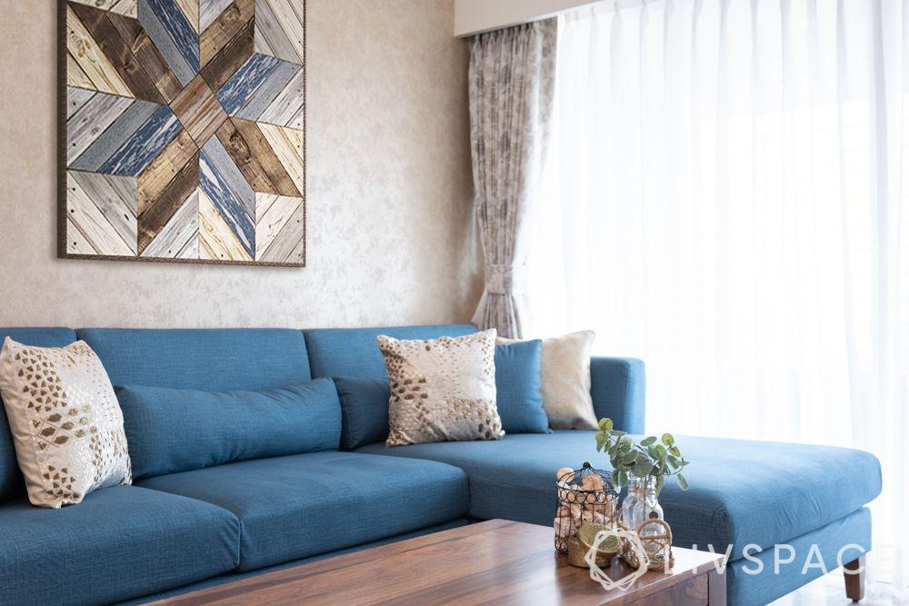 best home designers-living room-blue sofa