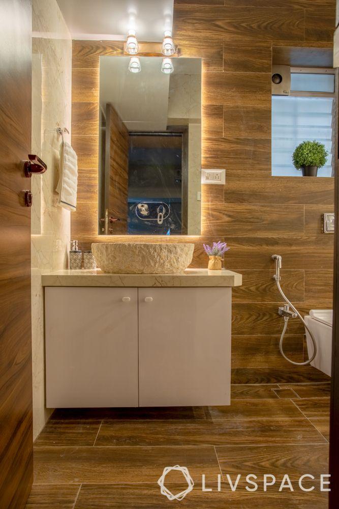 2bhk mumbai interiors-bathroom-mirror lighting-cecilia marble basin-laminate storage