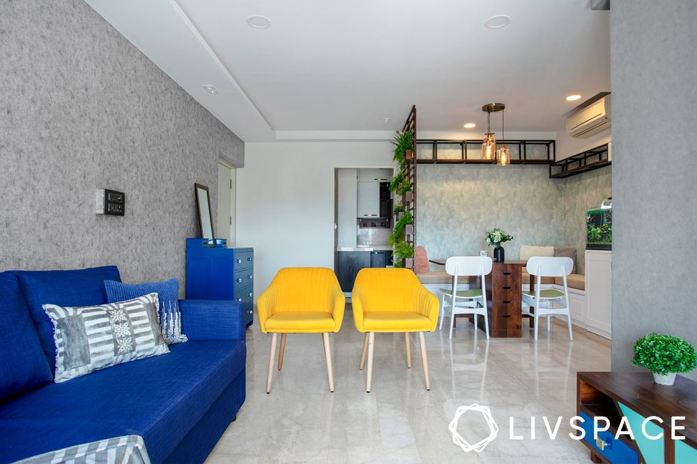 2bhk house design-living room-blue sofa-accent chairs-jaali partition