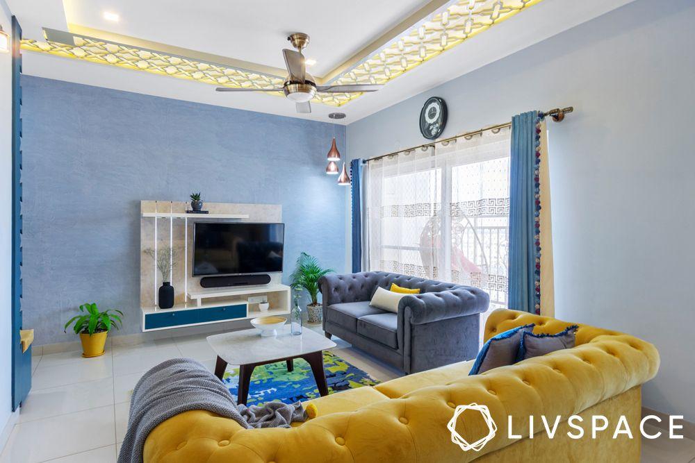 2BHK house design-living room-tufted sofa-TV unit-false ceiling