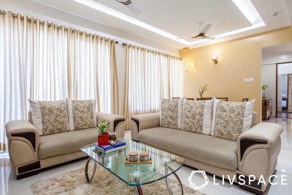 2BHK house design-living room-sofa-false ceiling