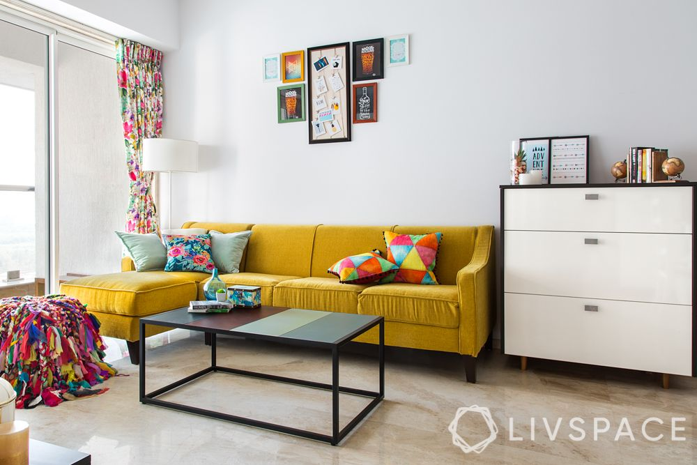 livspacehomes-low budget house-living room-colourful pouf-yellow sofa-artsy