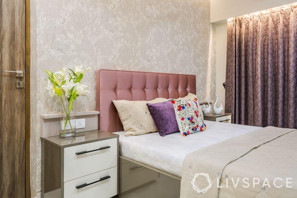 livspacehomes-mumbai interiors-daughters bedroom-subtle wallpaper-pink headboard-bedside tables