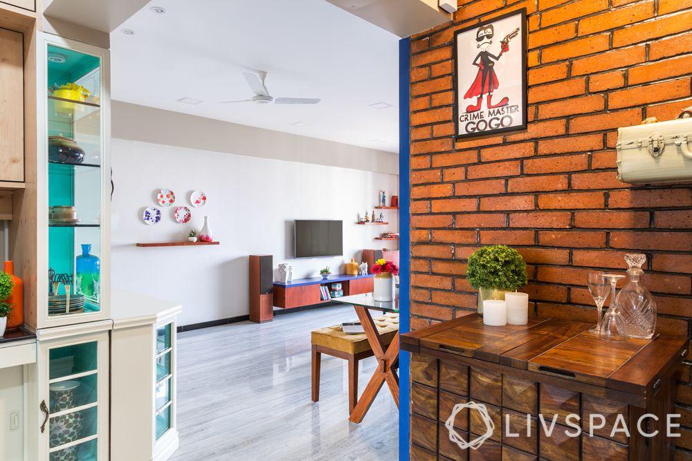 livspacehomes-mumbai interiors-dining room-living-exposed brick wall-crockery unit- tv unit