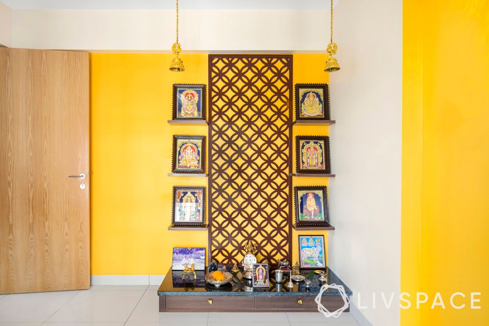 middle class indian style pooja room designs-yellow wall-jaali panel-pooja room