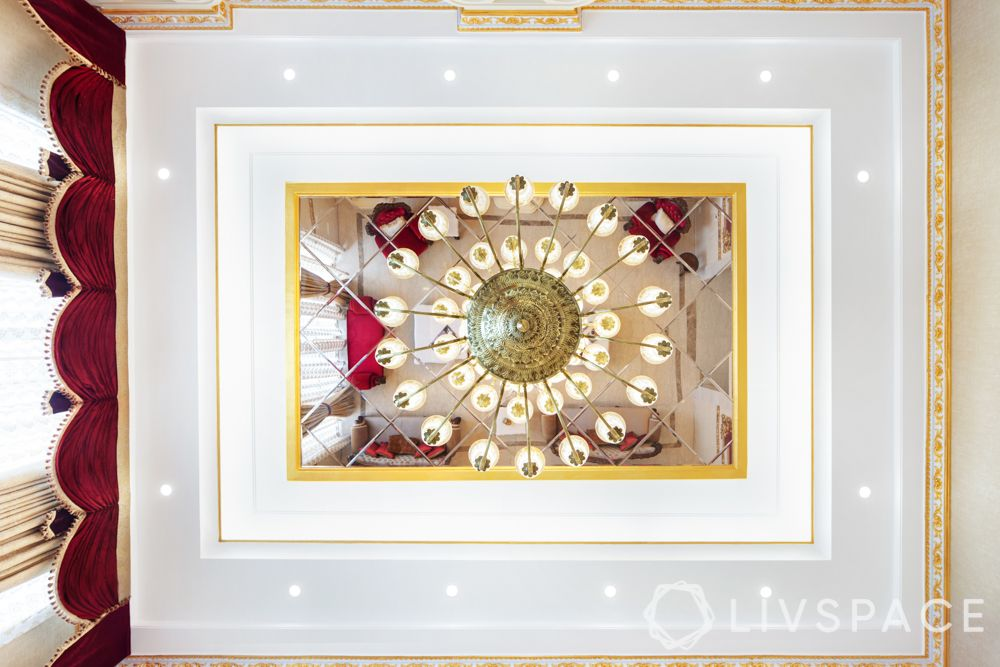 ceiling design-false mirror ceiling-chandelier-red and gold interiors