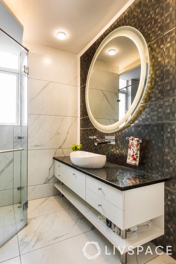 small bathroom designs India-statement mirror-sink