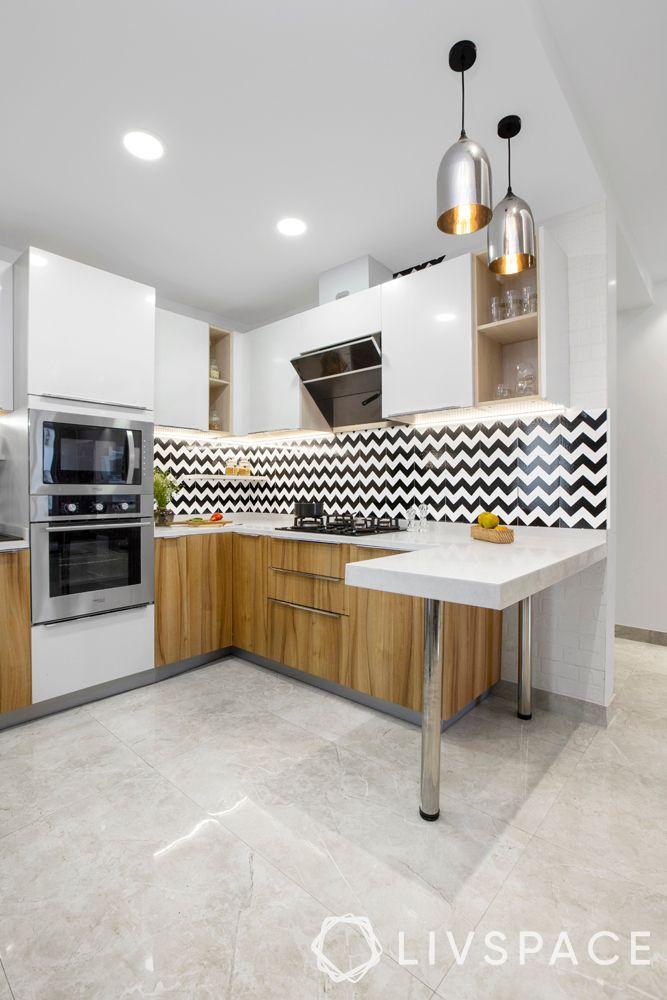 compact kitchen-neutral kitchen-white cabinets-backsplash