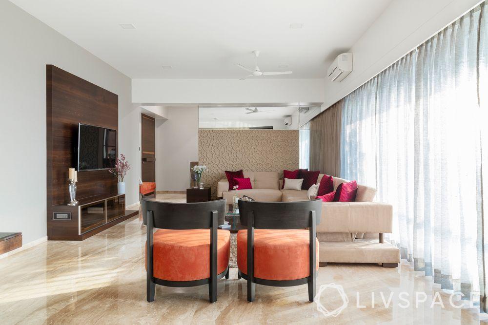 ajmera zeon-beige sofa-orange chairs