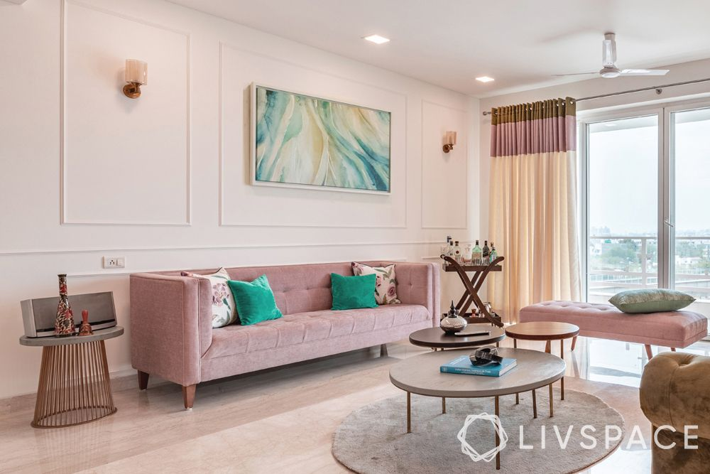 pastel shades-living room-dusty pink couch-wall trims