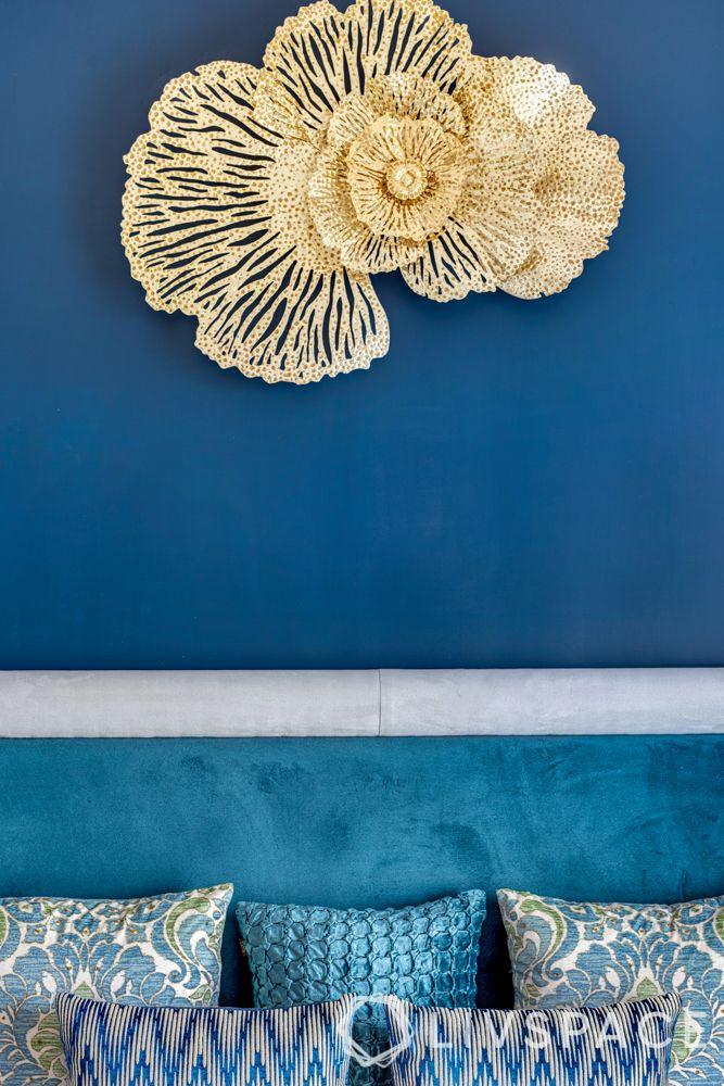 bedroom interior design-blue wall-gold wall decor-cushions