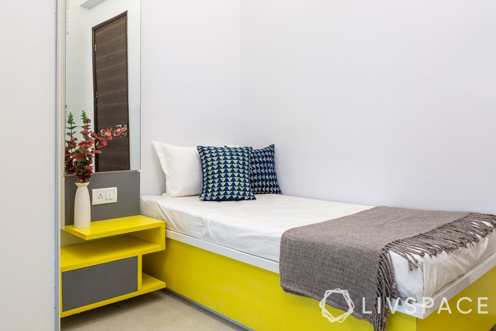 bedroom designing-yellow hydraulic bed-yellow side table cum dresser