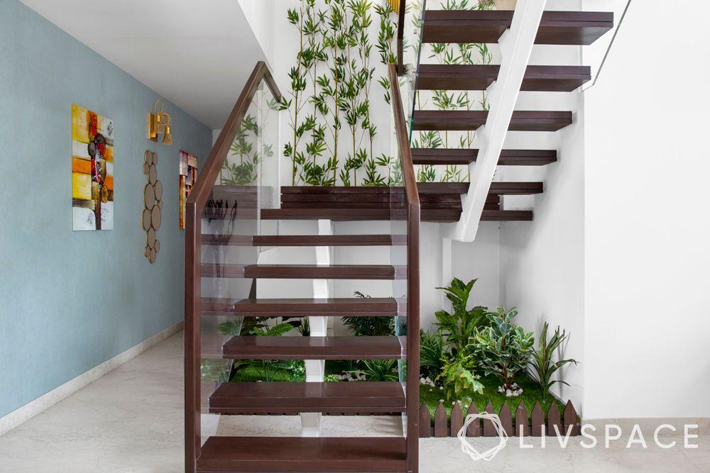 stairs design-garden below stairway-hanging creepers