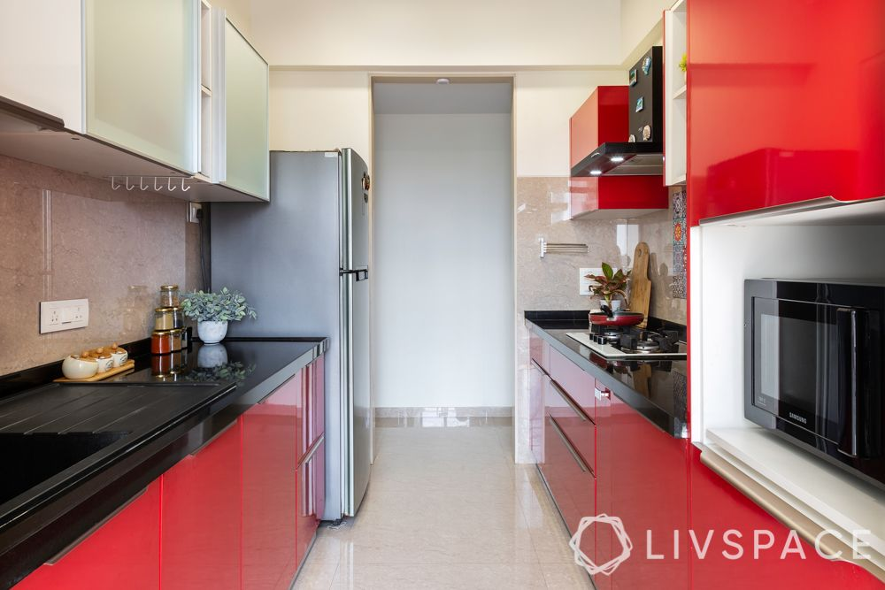 simple kitchen design for small house-red kitchen-red cabinets-black countertop
