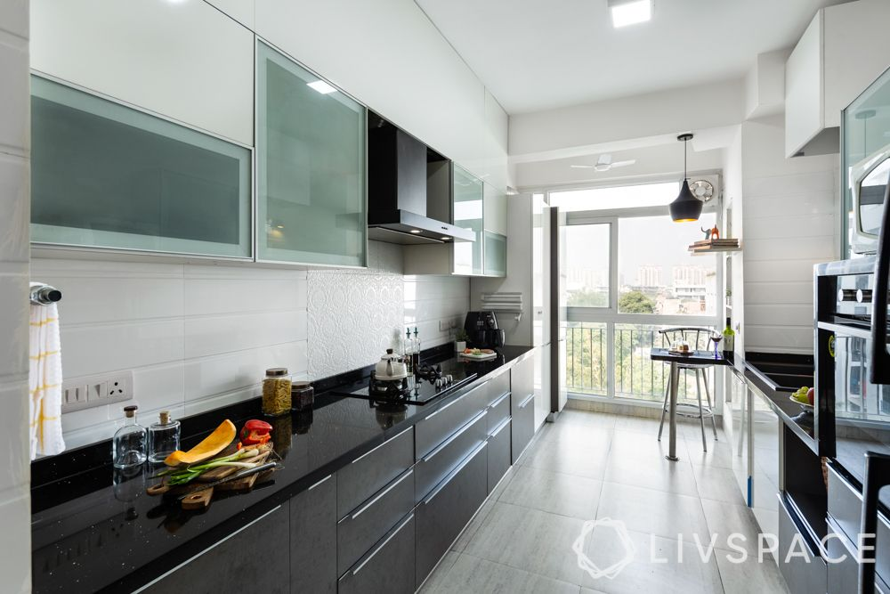 small kitchen design Indian style-airy kitchen-black counters-frosted glass shutters
